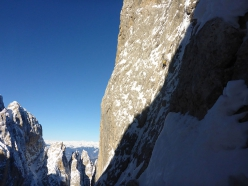 Langkofel Dolomites: Alessandro Baù finally on the sun as he makes his way to the first belay of Caddymania