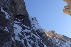 Giovanni Zaccaria final reaches the drip on pitch 2 of Caddymania, Langkofel, Dolomites