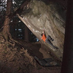 Giuliano Cameroni making the first ascent of REM, an 8C+ boulder next to Dreamtime in Cresciano