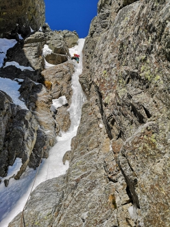 Tito Arosio climbing ice on the lower section of the new route on the East Face of Piz Buin, established on 31/03/2019 with Rosa Morotti