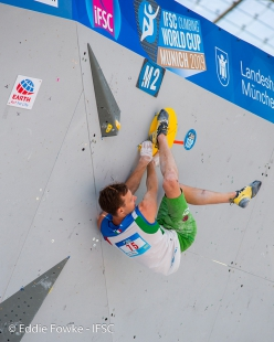 Michael Piccolruaz competing in the Bouldering World Cup 2019 at Munich