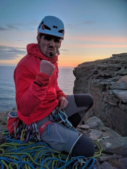 Jesse Dufton on the top of The Old Man of Hoy, Orkney Islands, Scotland