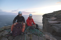 Jesse Dufton and Molly Thompson on the summit of The Old Man of Hoy, Orkney Islands, Scotland