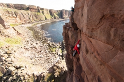 Jesse Dufton and Molly Thompson climbing The Old Man of Hoy, Orkney Islands, Scotland