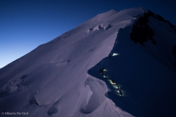 Mountaineers climbing towards the summit of Mont Blanc