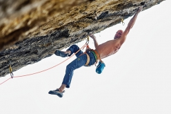 Swiss climber Cédric Lachat repeating the 9a+ Sweet Neuf at Pierrot Beach in France