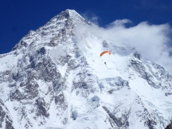 Max Berger paragliding off Broad Peak, with K2 in the background