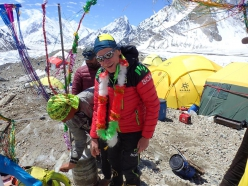 Max Berger back at Broad Peak Base Camp after having paraglided from 7100 meters