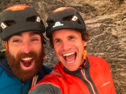 Sean Villanueva and Roger Schaeli on the top of the Eiger's Czech Pillar after having made the first one-day ascent of La Vida es Silbar
