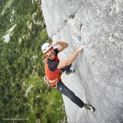 Yeah! Siebe Vanhee celebrating on Yeah Man, the 8b+ multi-pitch Gran Pfad, Gastlosen, in Switzerland