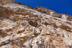 Climbing Via Costantini - Apollonio up the Pilastro della Tofana di Rozes in the Dolomites. First ascended by Ettore Costantini and Renato Apollonio on 13 July 1944, this is surely the most famous and popular route on the pillar thanks to its intrinsic beauty and perfect line.