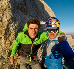 Mirco Grasso and Aaron Durogati shortly before their paraglider flight from the ledge at half-height on the South Face of Marmolada in the Dolomites