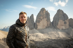 Dani Arnold in front of the Tre Cime di Lavaredo, Dolomites after his free solo ascent of the Comici - Dimai route on 5 September 2019 in just 46 minutes and 30 seconds. He told planetmountain.com 'I didn't have the slightest idea I was that quick. I felt relatively relaxed and everything went smoothly, perfectly I'd say even. It was a great day in the mountains.