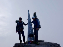 David Hefti and Marcel Schenk on the summit of Pizzo Badile after having climbed Free Nardella