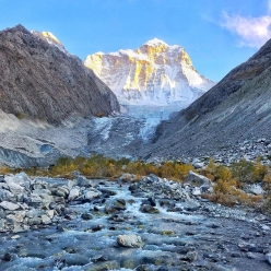 Koyo Zom (6877m) is a beautiful mountain in the Hindu Raj range in Pakistan. 'Like a medieval castle in the wilds of Asia, it's bulk looks out towards Afghanistan and Tajikistan'. Its unclimbed west face was first ascended by Tom Livingstone and Ally Swinton