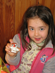 Zalia Rakhmetov with a snowman she built on her own