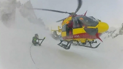 The rescue of two skiers from a crevasse on the glacier Mer de Glace, Vallée Blanche, Mont Blanc
