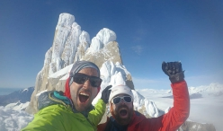 Nico Favresse and Sean Villanueva celebrating on the summit on Cerro Standhardt in Patagonia after having made the first ascent of making the first ascent of El Flechazo, 02/2020