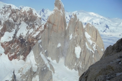Falling snow and ice on Cerro Torre and Torre Egger while repeating the 40° Ragni di Lecco route on Aguja Poincenot in Patagonia