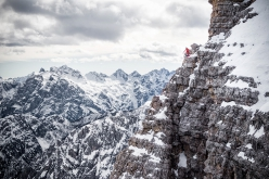 Simon Gietl preparing to abseil off Punta Frida during his solo winter enchainment of the Tre Cime di Lavaredo, Dolomites