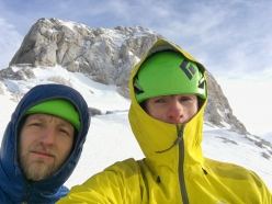 Marjan Kozole and Matej Balažic on the toip of the north face of Triglav in Slovenia after having climbed For Friends