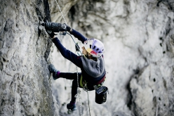 Angela Eiter bolting the climb Schatzinsel close to Imst in Austria
