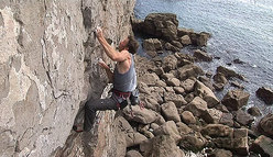 Dave Birkett repeating The Brothers Karamazov E9 6c a St Govan's Head, Pembroke, Wales