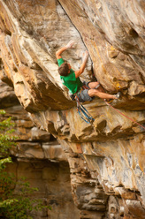 Brett Perkins skipping the bolts and placing trad gear on Proper Soul 5.14a R/X at the New River Gorge, USA.