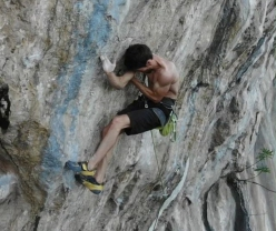 Stefano Ghisolfi on the crux moves of The Bow 9a+ at Padaro above Arco, Italy