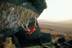 Ben Moon in 2006 making the first ascent of the 8B+ Voyager at Burbage North in the Peak District, England.