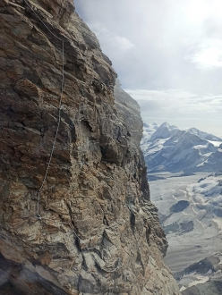 September 2020: the Italian Matterhorn Guides inform that due to rockfall the Échelle Jordan ladder is currently inaccessible. The guides have equipped a new line to the left of the ladder (in this photo) in order to reach the summit.