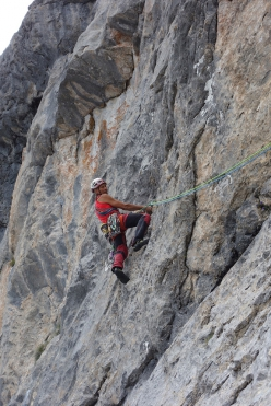 Roberto Mazzilis dealing with the crux of Carnici on Creta delle Cjanevate, first ascended with Roberto Simonetti on 6 October 1983.