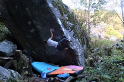 Stefan Scarperi making the first ascent of the 8C boulder problem Big Illusion in Val Daone, Italy