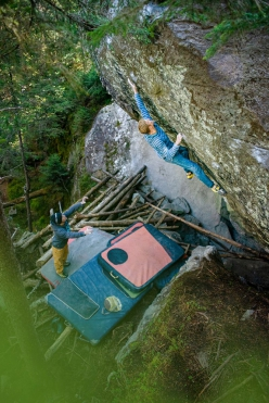 Jakob Schubert making the first ascent of the 8C boulder problem La Force Tranquille Direct at t Magic Wood in Switzerland