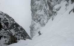 Snowboarding down the SW couloir of Col du Brouillard