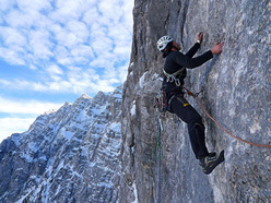 Tomaž Jakofčič climbing difficult rock on Metropolis (VIII/VII+, A0, 350m), Triglav North Face.