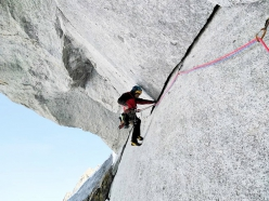 John McCune traversing below the big roof during the first ascent of Above and Beyond on Aiguille de Pélerins in the Mont Blanc massif