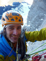 Fabio Valseschini jumaring up through the overhangs on Via dei 5 di Valmadrera, Civetta, Dolomites