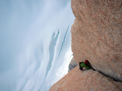 Sean Villanueva on the triple cracks pitch 18 of El Corazon, East Face of Fitz Roy, Patagonia.