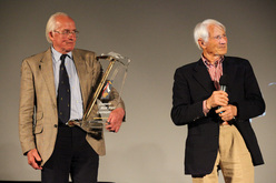 Britain's Doug Scott receives the Lifetime Achievement Award from Walter Bonatti.