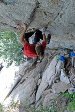 Simone Pedeferri climbing at the Grotta del Ferro in Val di Mello, Italy