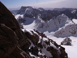 Jim Broomhead on Peak Alexandra with the still unclimbed peaks 5112 and 5025.