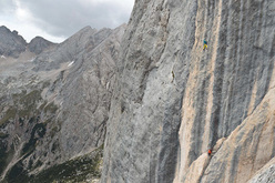 Hansjörg Auer making the first ascent of his route Bruderliebe (800m/8b/8b+), Marmolada, Dolomites.