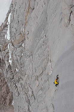 Hansjörg Auer soloing the Fish route, Marmolada, 2007. The photo was taken by Wilhelm a week after Auer's solo; he was lowered to the 19th pitch by his brother Matthias