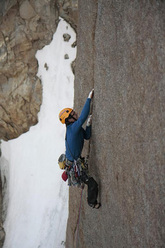 Michi Wyser during the first ascent of Serratit, Quvnerit Island, Greenland