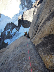 Tom Holzhauser during the first ascent of Serratit, Quvnerit Island, Greenland