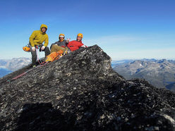 Toni Lamprecht, Tom Holzhauser and Michi Wyser on the summit of Serratit, Quvnerit Island, Greenland