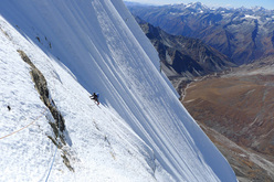 Dave Turnbull climbing the summit ice slopes on the first ascent of Gojung.
