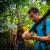 The team cut a new trail in the jungle.  Da Liu checks his cutting skills.