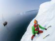 Klemen Premrl and Aljaz Anderle climbing iceberg in Greenland